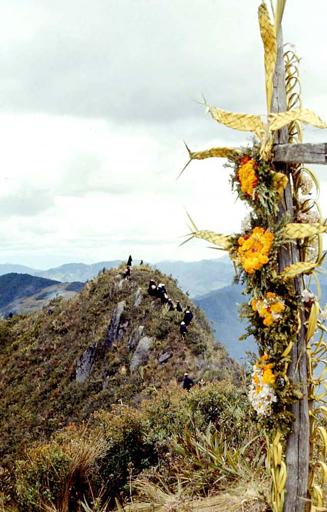 Saraguros decorate the cross on Mt. Puglla on Holy Cross day, 1971